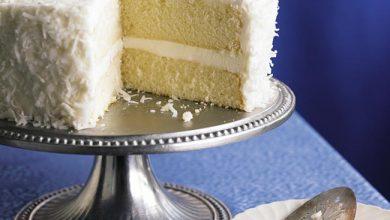 southern-sour-cream-coconut-layer-cake-390x220 آموزش طرز تهیه کیک نارگیلی خامه ای آشپزی کیک ها   وردنگار